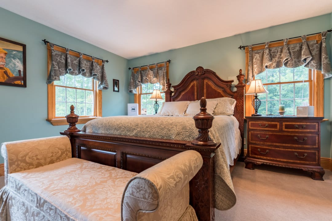 Ornate Queen bed with Captain Portrait